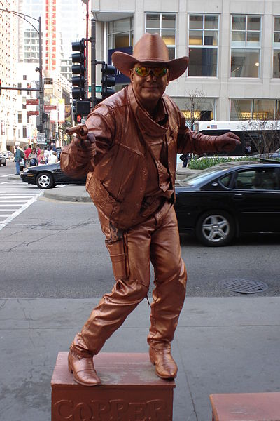 400px-The_Copper_Cowboy_living_statue-1